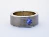 Silver och titanring med kubic zircon i riven fattning.